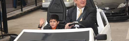 Marcelo Ebrard, Mayor of Mexico City, driving one of the electric vehicles of KidZania Cuicuilco