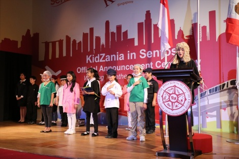Kids reading the 'KidZania Declaration of Independence', declaring their independence from adults
