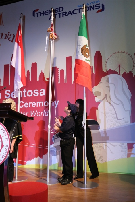 Raising of the KidZania flag to join the flags of Singapore and Mexico
