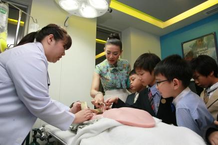 HRH Prince Dipangkorn as a surgeon at KidZania Bangkok's hospital