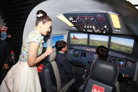 HRH Prince Dipangkorn Rasmijoti trying out one of KidZania Bangkok's flight simulators