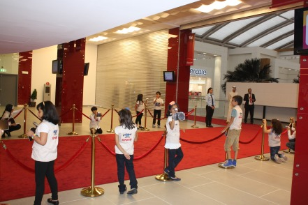 Kid journalists awaiting the arrival of guests at the red carpet.