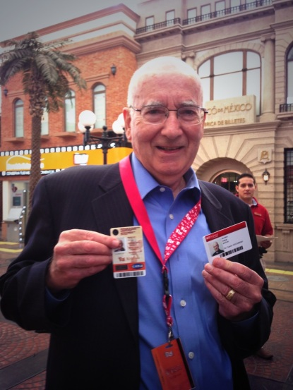 Prof. Philip Kotler proudly shows his driving license before jumping in a car and driving through the streets of KidZania Cuicuilco.