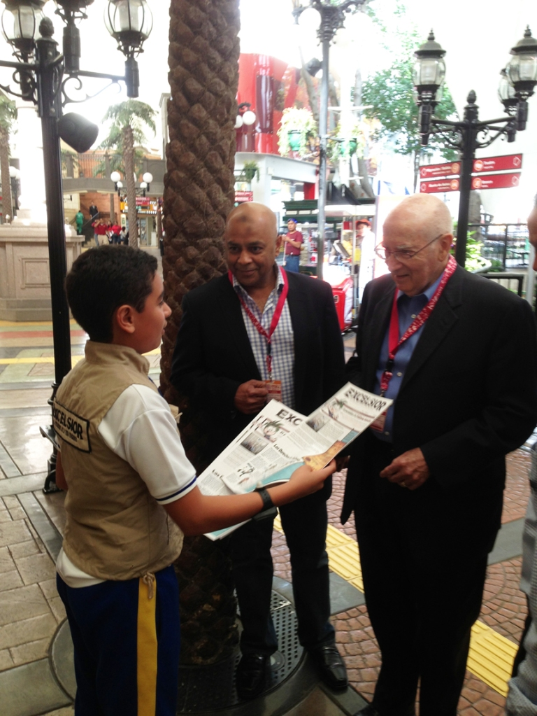 A young reporter gives Prof. Kotler a copy of today's paper.