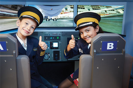 Young pilots at KidZania Mumbai's flight simulators