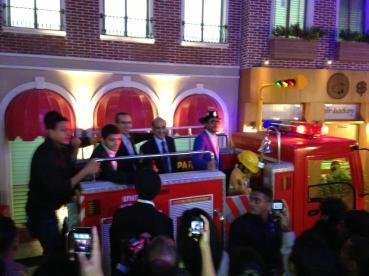 Shah Rukh Khan with Mr. Xavier López riding the Fire Truck at KidZania Mumbai