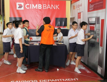 Finance is fun: Children making and completing bank transactions at CIMB Bank Berhad