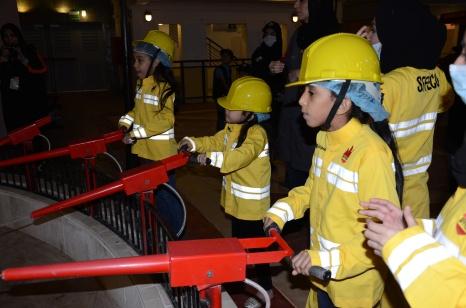 KidZania Jeddah - Putting down a fire