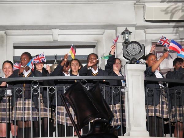 A choir of kids singing the KidZania National Anthem
